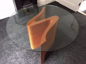 Glass dining table and S shaped wood base