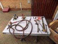 gas welding guns and various assessories and pipes