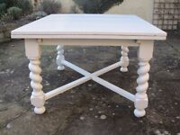 For sale, white painted oak table with barleysugar legs.