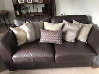 Brown leather sofas with cushions