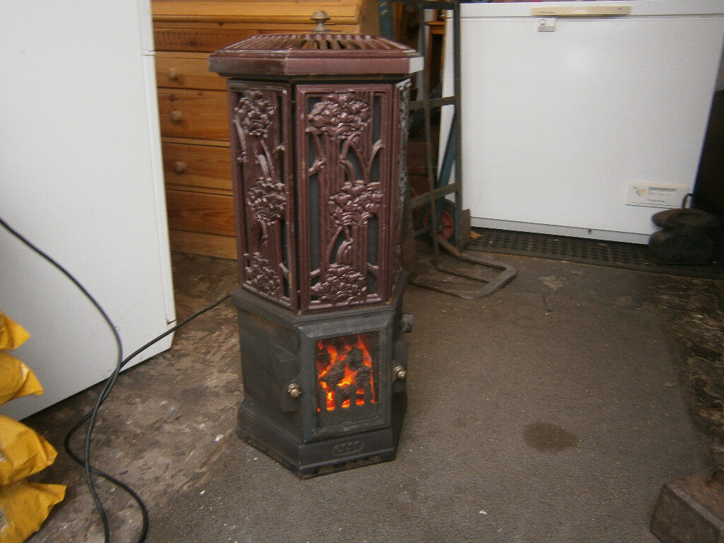 ESSE SOLO STOVE CAST IRON ELECTRIC HEATING STOVE RED ENAMEL VERY LIFELIKE STOVE IN YEOVIL