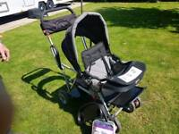 Joovy sit and stand pushchair.