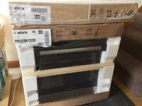 New unopened Bosch HBA23B152B Elec Oven Black & Silver + PIE611B18E Induction 59 cm Black Glass Hob