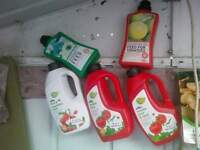 assorted liquid vegetable and tomato feed