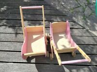 Two wooden dolls prams. Natural wood with pink trim.