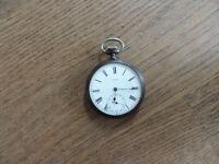A Vintage Tin Pocket Watch