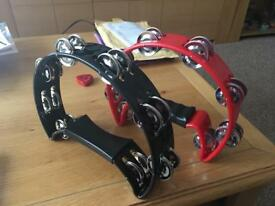 2 new tambourines. Red and black.