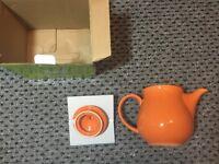 Yong old English teapot, ceramic orange.
