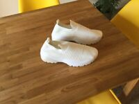A pair of ladies solid wedge trainer gym shoes, brand new.