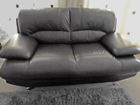 Nearly new Harvey's Brown Leather Sofa