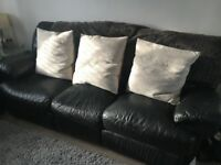 Harvey's black leather 2 seater and 3 seater recliner sofa