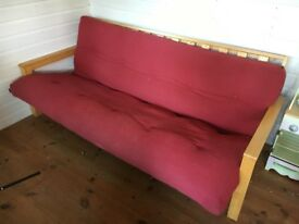 Used red futon double sofa bed