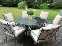 6 seater garden dining table and chairs. Granite.
