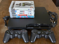Sony PS3 320 GB slim console with controllers and 5 games