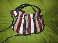Italian leather handbag bought in Italy. Genuine beautiful leather. Quite heavy. £30.