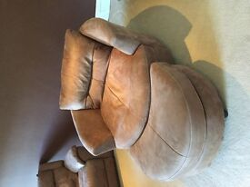 Large tan snuggle swivel chair
