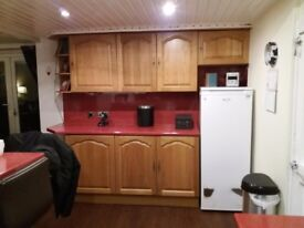 Solid Oak kitchen with electric oven and gas hob