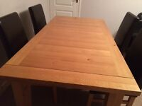 Beautiful solid oak table and four leather chairs