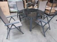 Black Glass Table with 4 Reclining Chairs