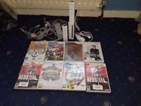 Nintendo Wii Bundle (2 Official Controllers, Nunchuck, 5 Games)