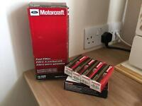 Ford F-150 lightning fuel filter and spark plugs (8) brand new. Genuine ford motorcraft.