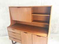 1970's mid century Europa Furniture tall sideboard / cabinet with teak veneered finish