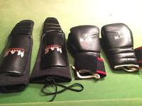 Boxing gloves and shin pads