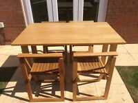 Oak console table and four oak folding chairs
