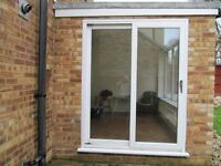 Alpine Patio door & Window.A rated for energy .pvc with toughened glass.Good condition.