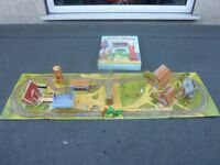 Pop up book into village train track.