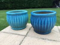 2 blue plant pots