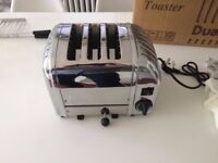 Dualit 3 slice toaster with sandwich holder. Polished chrome finish. Brand new, boxed/never unused