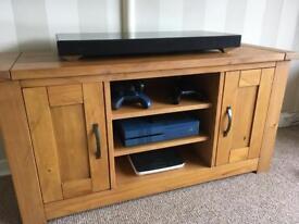 Solid wood TV unit.