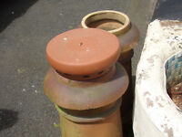 Terracotta chimmey pots and cow