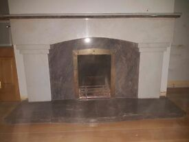 Grey and white marble fireplace and hearth