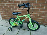 Childs green bike with stabilisers