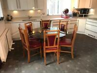 Round Tinted Glass Dining Table With 6 Red Leather Wood Chairs