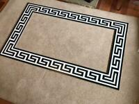 Exquisite Versace style Greek Key black and white tile borders floor and wall