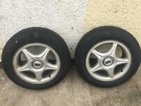 2 brand new tyres with used wheel hubs