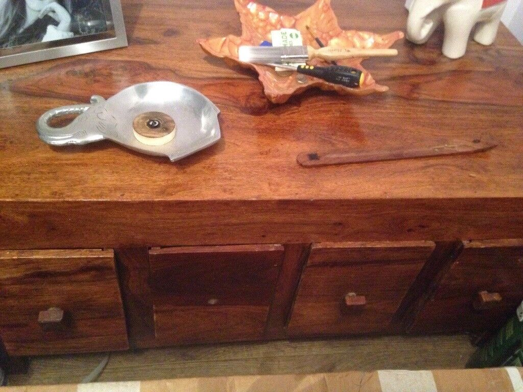 Solid real wood One knob missing but have new ones to put on if disired
