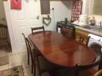 Dark wood extending dining table with six chairs