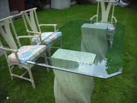 Modern Glass Table with 6 Cane Arm Chairs with Floral Upholstered Cushions