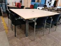 Large office boardroom table with stackable chairs
