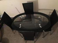 Glass dining table and 4 chairs *sorry sold too many emails to reply to*
