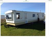 Dornoch Beach Front Caravan for that family fun or a couple retreat