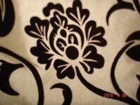 Cream curtains with a dark brown flock