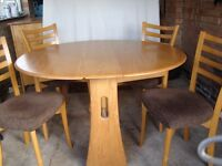 Family Dining Table with four chairs plus matching three door sideboard