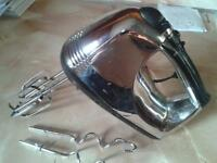 crome n black hand mixer with two sets of blades
