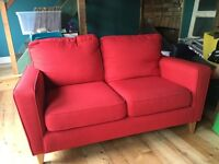 Almost new 2 seater red sofa from Harveys.