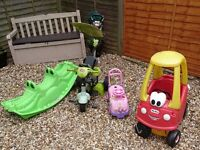 Job lot of outdoor toys, car, seesaw, trike, sit on car